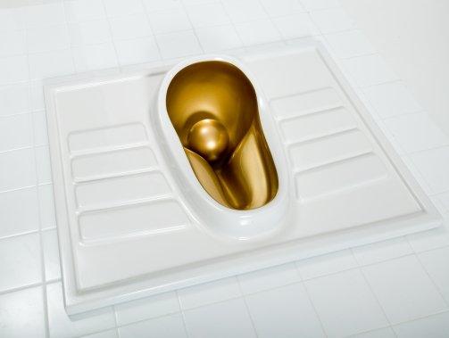 women-peeing-gold-urinal