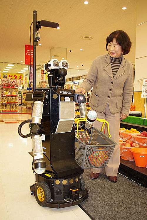 Robovie-II helps you with your grocery shopping